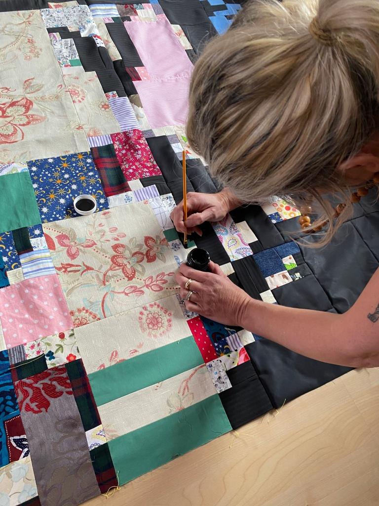 Adding Finishing Touches To The Mosaic.